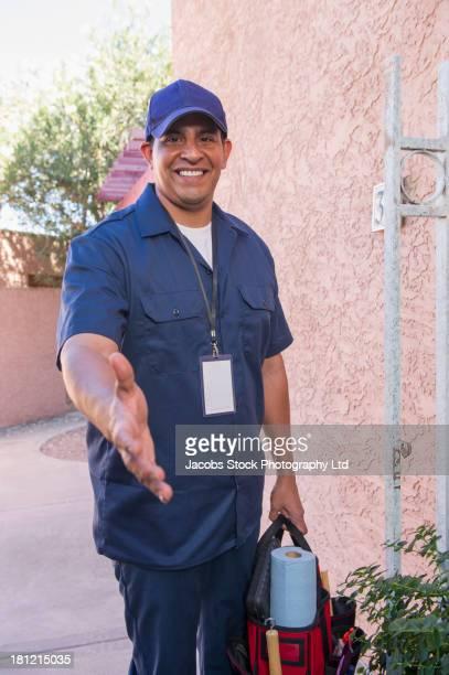 Hispanic worker offering handshake