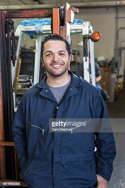 Hispanic worker smiling in warehouse