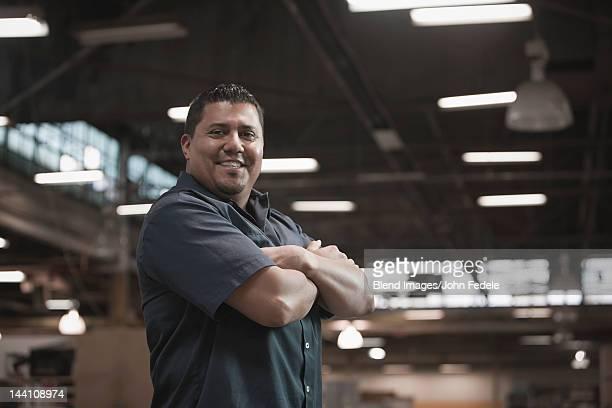 Hispanic worker standing in warehouse