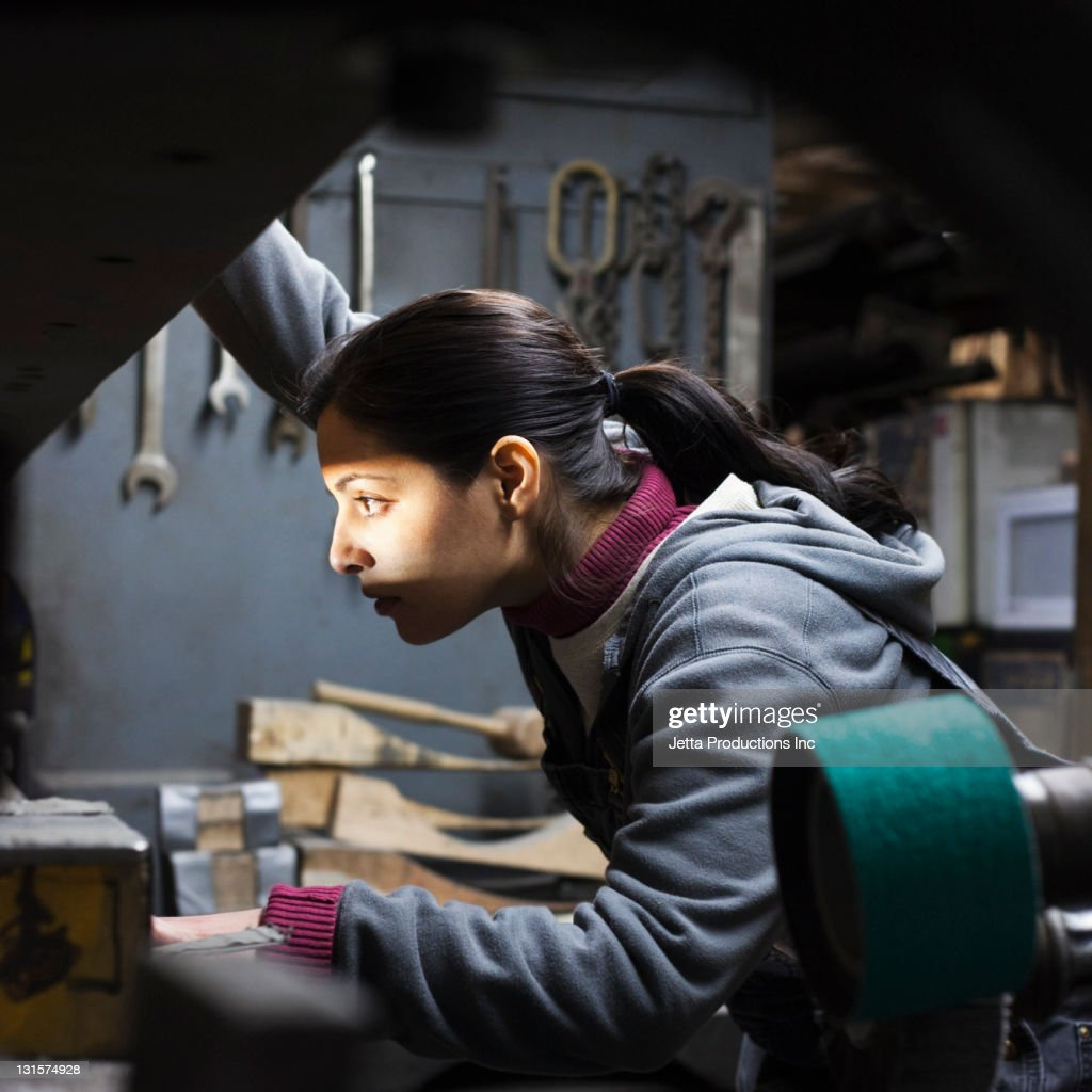 Hispanic worker working in factory : Stock Photo