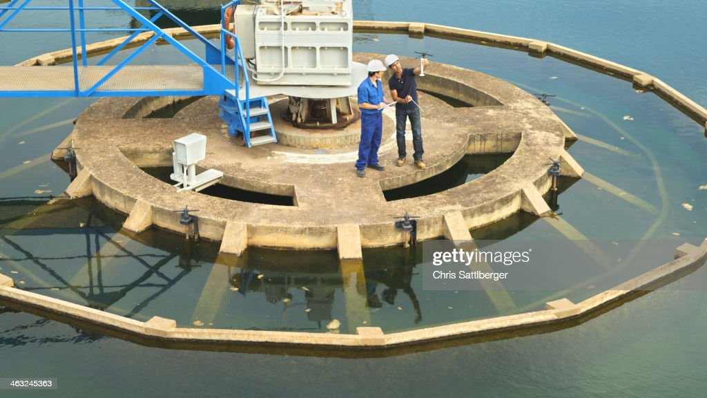 Hispanic workers checking water quality