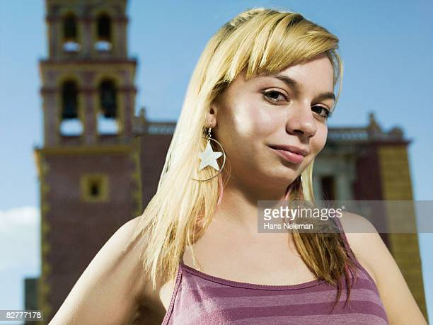 A hispanic young woman in front of the church