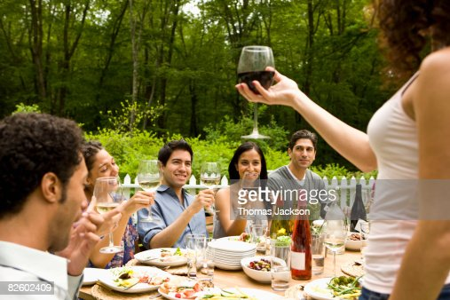Hispanics at outdoor garden party at country home