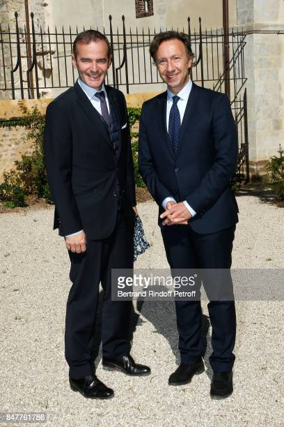 Historian Franck Ferrand and Stephane Bern attend Members of the Stephane Bern's Foundation for 'L'Histoire et le Patrimoine' visit the 'College...