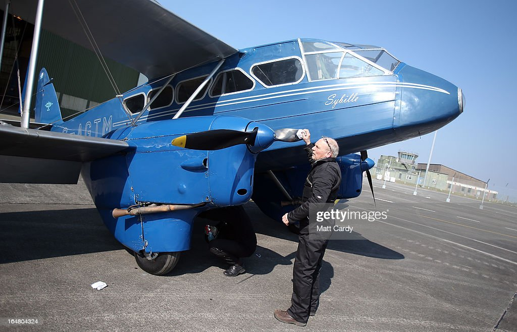 A historic 1930s de Havilland Dragon Rapide aircraft is prepared for flight at the Classic Air Force museum, based at Newquay Cornwall Airport, as it prepares to open its doors to the public for the first time tomorrow, on March 28, 2013 in Newquay, England. The museum will eventually home a collection of vintage aircraft - the Classic Air Force, the only collection of flyable post-1945 British aircraft - and will include among the collection, the oldest British jet capable of flight (a 1948 Gloster Meteor) and the Canberra jet bomber that obtained the World Altitude Record for Britain in 1957. In total around 30 aircraft will ultimately be based in the Classic Air Force hanger with pleasure flights offered in a range of aircraft including a 1930s-era Dragon Rapide.