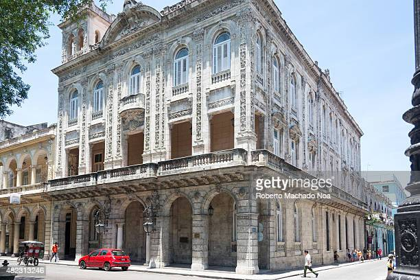 Historic building in Old Havana part of the Cuban heritage from the colonial era The old white stone building features columns and arches and modern...