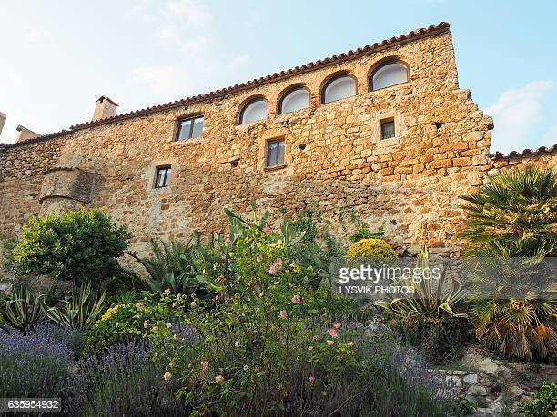 Historic buildings La Muralla in medieval town Pals, Catalonia