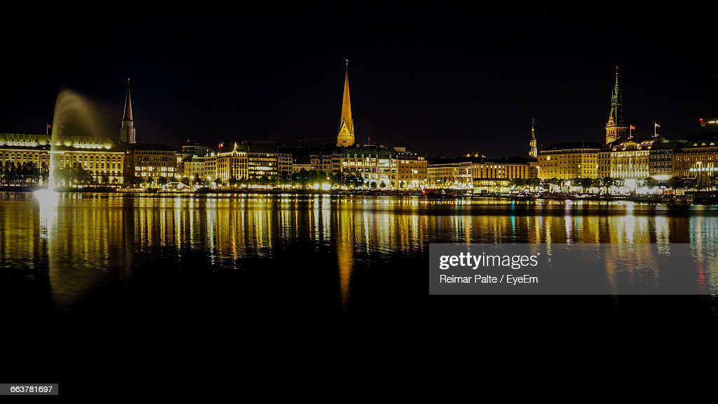 Historic Buildings Reflection In Binnenalster Against Sky At Night