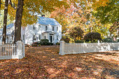 Historic federal style home with a white picket fence in Deerfield, Massachusetts.