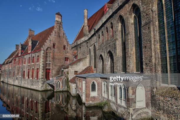 Historic Flemish style brick buildings reflected in a canal in the city of Bruges in Belgium Europe Bruges also known as the Venice of the North is...