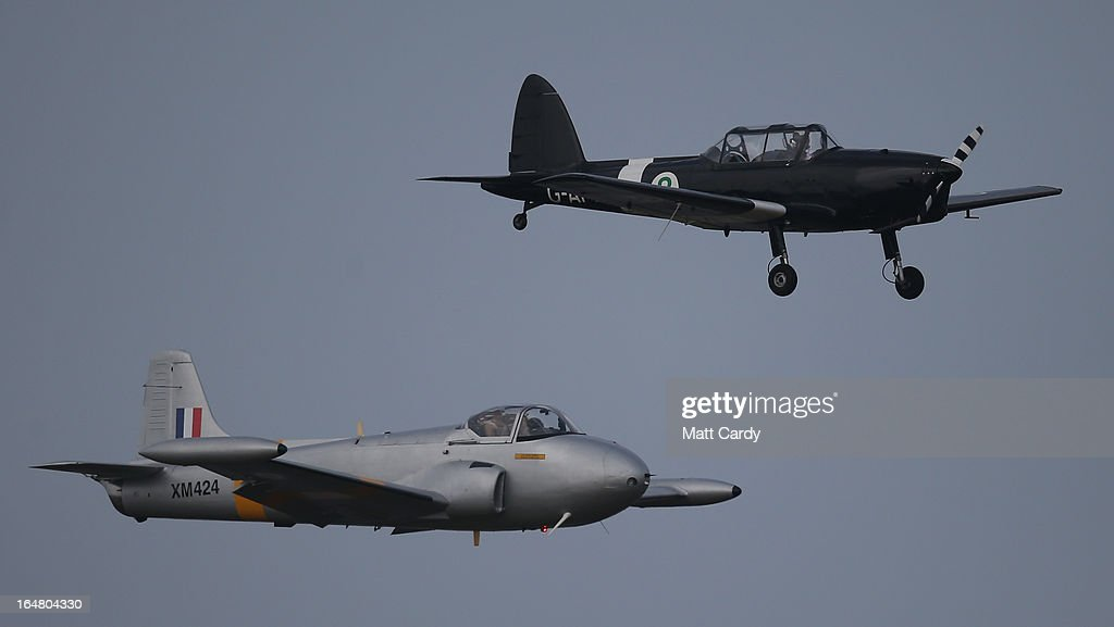 A historic Jet Provost aircraft (below) flies alongside a Chipmunk plane at the Classic Air Force museum, based at Newquay Cornwall Airport, as it prepares to open its doors to the public for the first time tomorrow, on March 28, 2013 in Newquay, England. The museum will eventually home a collection of vintage aircraft - the Classic Air Force, the only collection of flyable post-1945 British aircraft - and will include among the collection, the oldest British jet capable of flight (a 1948 Gloster Meteor) and the Canberra jet bomber that obtained the World Altitude Record for Britain in 1957. In total around 30 aircraft will ultimately be based in the Classic Air Force hanger with pleasure flights offered in a range of aircraft including a 1930s-era Dragon Rapide.