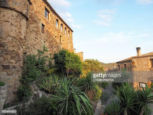 Historic La Muralla buildings in medieval town Pals, Catalonia