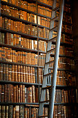 """Book shelves with historic books at Trinity College Library """"The Long Room"""", Dublin, Ireland"""