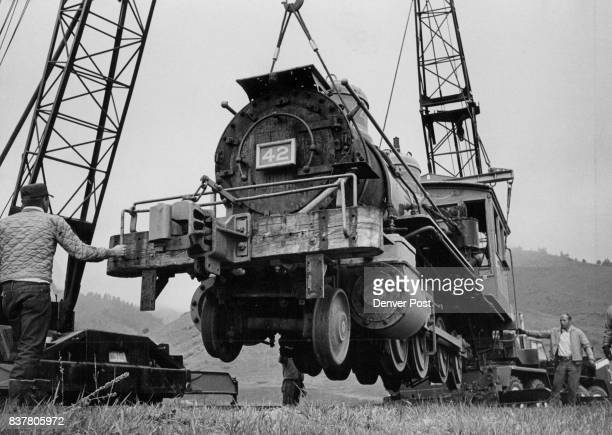 Historic Locomotive heads back into action at Foothills development Workmen for the Woodmoor Corp use cranes to hoist old No 42 one of the last...