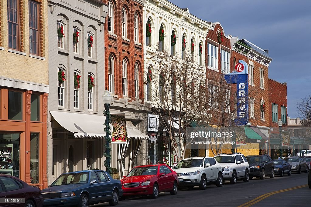 Historic Main Street with Red Brick Storefronts parked cars and Grays Pharmacy in Franklin Tennessee a suburb south of Nashville Williamson County...