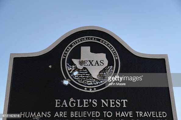 A historic marker damaged by bullet holes stands along the Rio Grande on the USMexico border on October 16 2016 in Landry West Texas In Texas late...