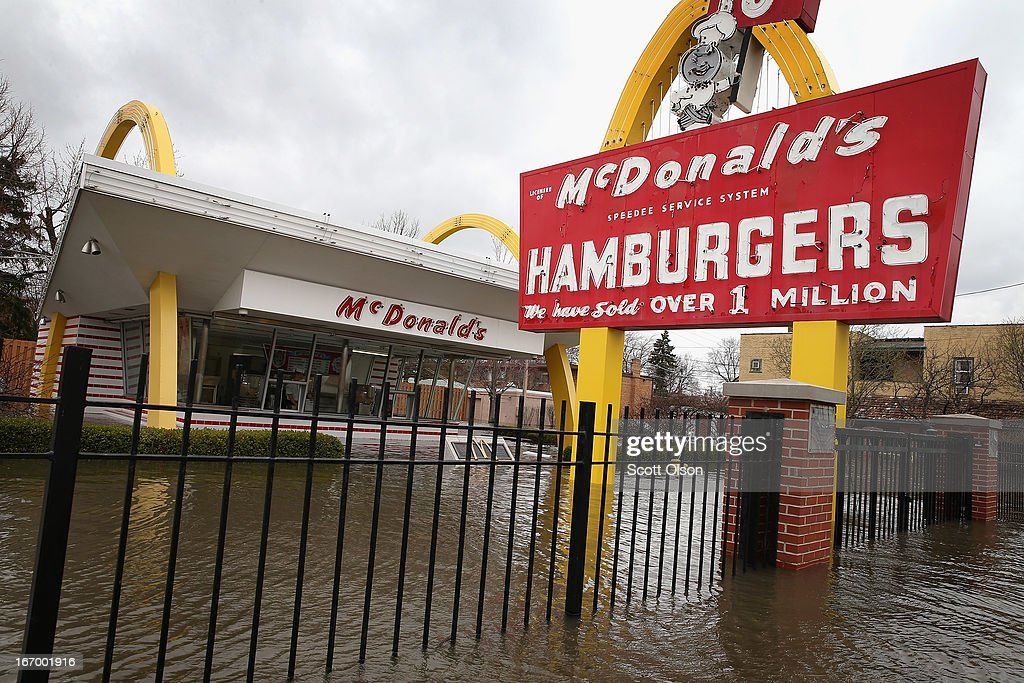 A historic McDonald's restaurant is surrounded by floodwater April 19, 2013 in Des Plaines, Illinois. The restaurant is located on the site of the first McDonald's franchise opened by founder Ray Kroc on April 15, 1955. The suburban Chicago town is battling rising floodwater from the Des Plaines River which is expected to crest at a record 11 feet later today. Record-setting rains and rising rivers have caused wide-spread flooding in many Illinois communities.