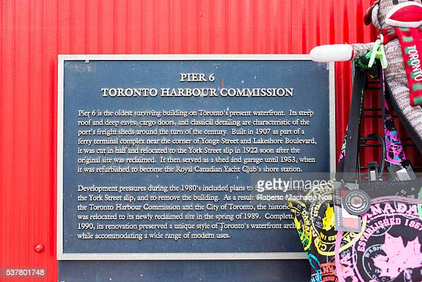 Historic plaque with the history of Pier 6 or Toronto Harbor Commissioners Building The landmark is currently the BeaverTails store The pastry is...