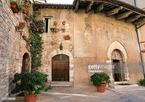 Historic Stone Buildings on a Narrow Street, Assisi, Umbria, Italy.