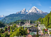 Historic town of Berchtesgaden with snowy Watzmann mountain in spring, Berchtesgadener Land, Upper Bavaria, Germany