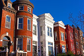Colorful residential row houses in US capital before sunset in late autumn.