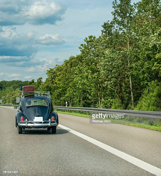 Historic VW Bug  with Luggage on the roof