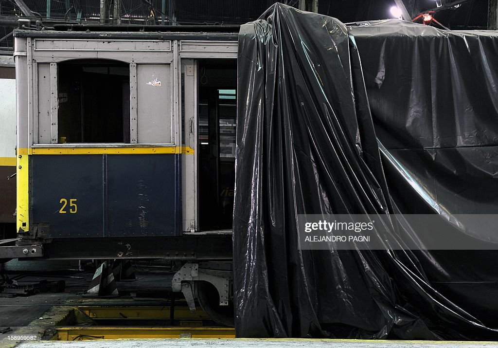 A historic wagon of La Brugeoise remains parked at the garage El Polvorin, in the neighborhood of Caballito, Buenos Aires on January 4, 2013. The Line A will be closed betwen January 12 and March 8 following a decision by Buenos Aires city Mayor Mauricio Macri to replace the fleet with Chinese-made wagons. Line A was the first subway line to work in the southern hemisphere and its trains are among the ten oldest still working daily. The La Brugeoise wagons were constructed between 1912 and 1919 by La Brugeoise et Nicaise et Delcuve in Belgium.