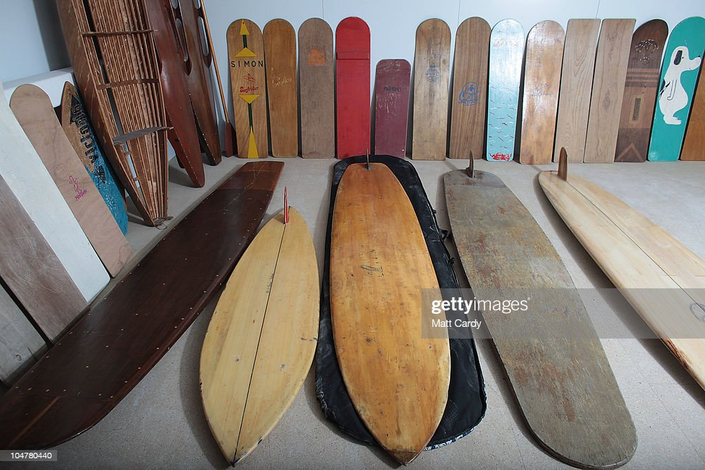 Historic wooden surfboards belonging to the Museum of British Surfing and currently being kept in storage are displayed in a warehouse on October 4, 2010 in Braunton, England. The Museum of British Surfing, a charity which originally started online, has been touring the UK since 2004 and is Europe's first surf museum. It holds the largest surfboard collection in Britain and has secured funding for a permanent home, which will open in Braunton next summer. As well as the collection of surfboards dating back over 100 years, the museum also holds early wetsuits, photos and other memorabilia relating to the phenomenal growth in the popularity of surfing. Although many people assume surfing in the UK began in the 1960s, the museum contains evidence that show that it was in fact already a mass participant activity on British beaches by the end of the First World War. Surfing is now a multi-million pound industry and employs 1000s of people in the UK.