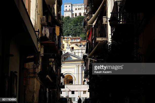 Historical buildings seen at the end of an alleyway in the Spanish quarters on October 17 2015 in Naples Italy
