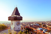 Historical Clock tower Uhrturm and old town in Graz, Austria