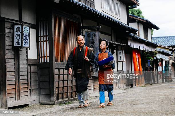 Historical Japanese village and father and son walking