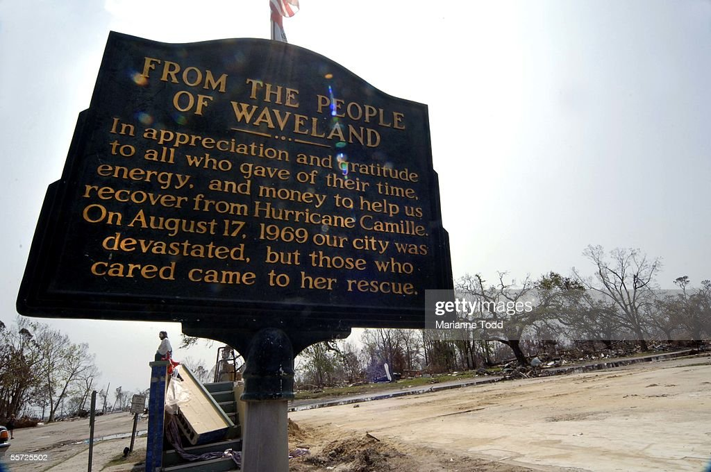 A historical marker thanking people for coming to aid after Hurricane Camille hit Waveland in 1969 sits amit a wiped out neighborhood left by...