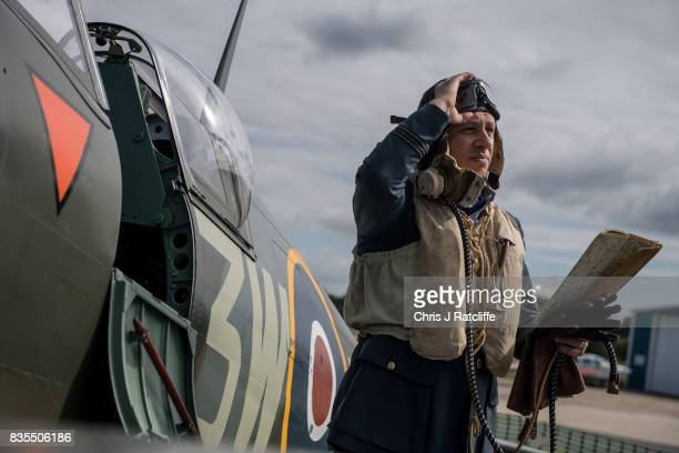 Historical reenactor and pilot Nigel Carver poses for photographs next to a Spitfire at the Biggin Hill Festival of Flight on August 19 2017 in...