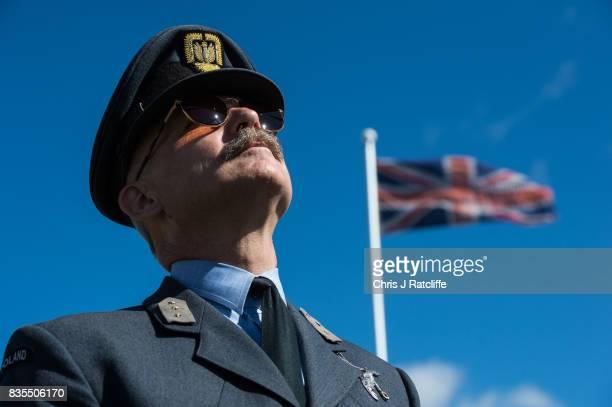 A historical reenactor dressed as Second World War Polish pilot Marek Stefanicki is seen at the Biggin Hill Festival of Flight on August 19 2017 in...
