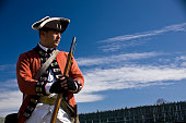 Historical reenactor portraying a British Soldier at Fort Michilimackinac State Park