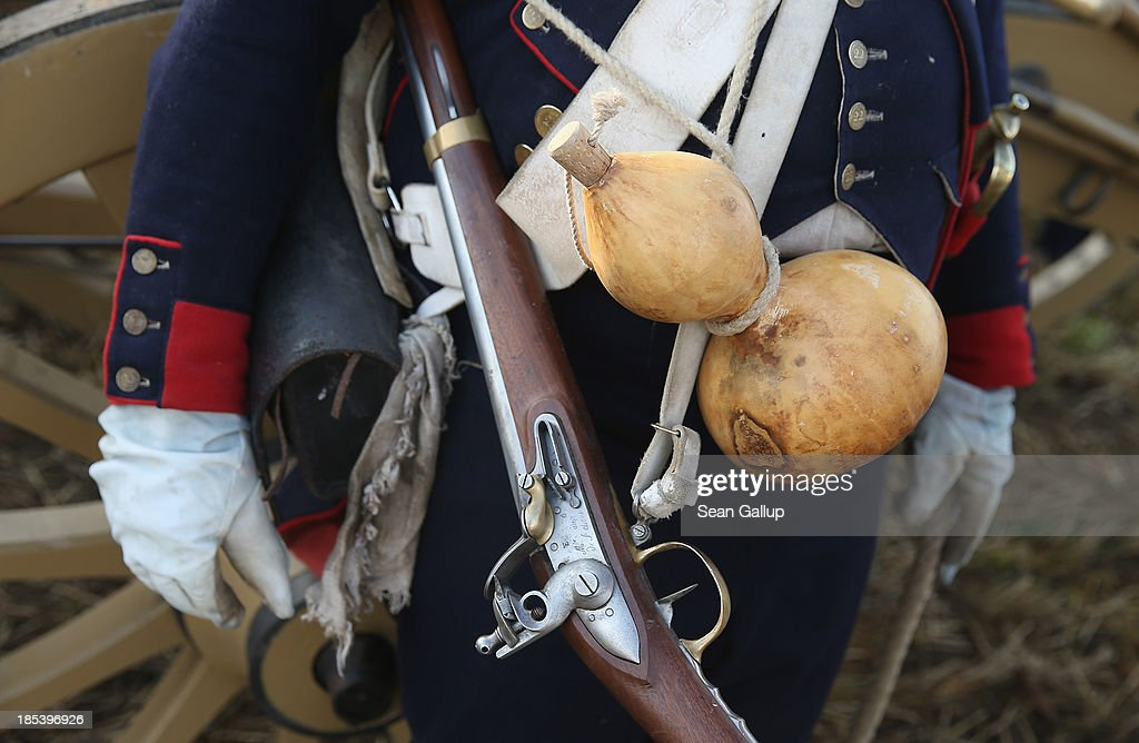 A historical society enthusiast in the role of a French artillery soldier fighting under Napoleon take arrives with a musket and water gourd to re-enact The Battle of Nations on its 200th anniversary on October 20, 2013 near Leipzig, Germany. Over 6,200 actors from 26 countries are participating in the massive re-enactment of the battle that originally pitted 600,000 Austrian, Prussian, Russian and Swedish forces against Napoleon's army near Leipzig in 1813. napoleon's defeat forced him to retreat toward France and sealed the end of his Central European military expansion.