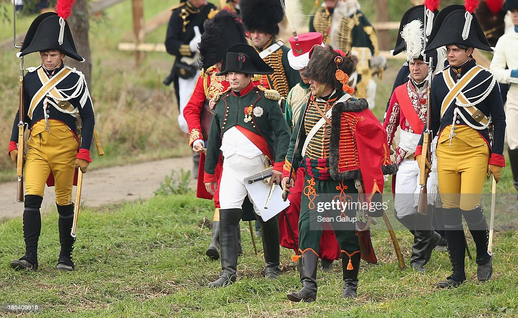 A historical society enthusiast in the role of Napoleon (C) walks with members of his commanding staff during the re-enactment of The Battle of Nations on its 200th anniversary on October 20, 2013 near Leipzig, Germany. Over 6,200 actors from 26 countries are participating in the massive re-enactment of the battle that originally pitted 600,000 Austrian, Prussian, Russian and Swedish forces against Napoleon's army near Leipzig in 1813. Napoleon's defeat forced him to retreat toward France and sealed the end of his Central European military expansion.