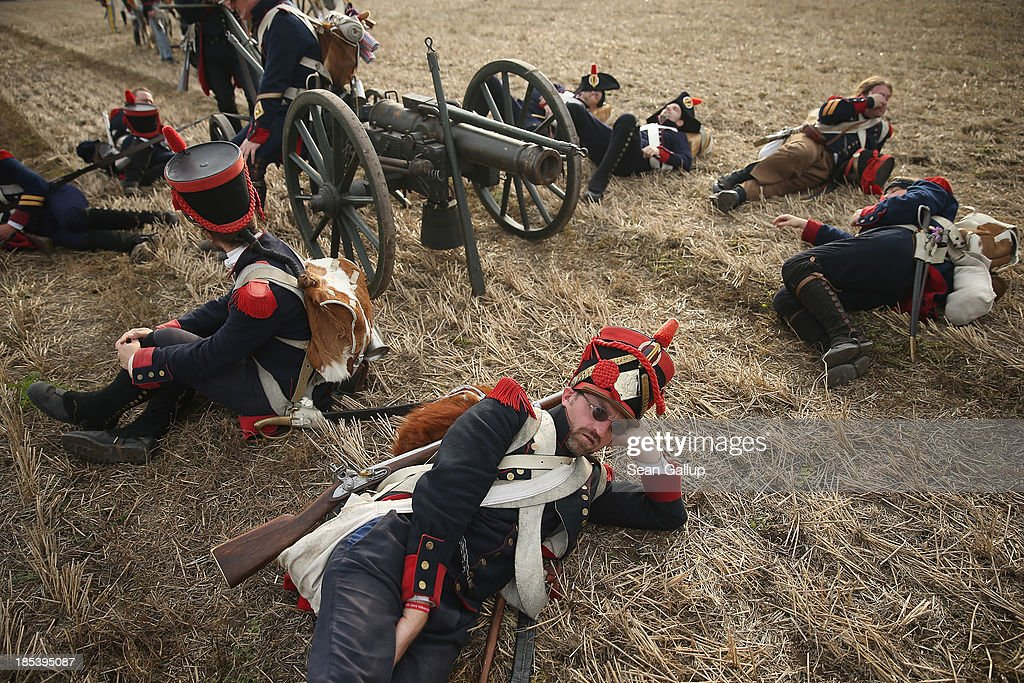 Historical society enthusiasts from the Czech Republic in the role of French artillery soldiers fighting under Napoleon take a break upon their arrival to re-enact The Battle of Nations on its 200th anniversary on October 20, 2013 near Leipzig, Germany. Over 6,200 actors from 26 countries are participating in the massive re-enactment of the battle that originally pitted 600,000 Austrian, Prussian, Russian and Swedish forces against Napoleon's army near Leipzig in 1813. napoleon's defeat forced him to retreat toward France and sealed the end of his Central European military expansion.