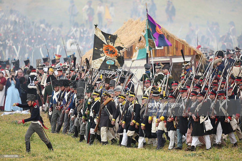 Historical society enthusiasts in the role of Allied soldiers advance against troops loyal to Napoleon during the re-enactment of The Battle of Nations on its 200th anniversary on October 20, 2013 near Leipzig, Germany. Over 6,200 actors from 26 countries are participating in the massive re-enactment of the battle that originally pitted 600,000 Austrian, Prussian, Russian and Swedish forces against Napoleon's army near Leipzig in 1813. Napoleon's defeat forced him to retreat toward France and sealed the end of his Central European military expansion.