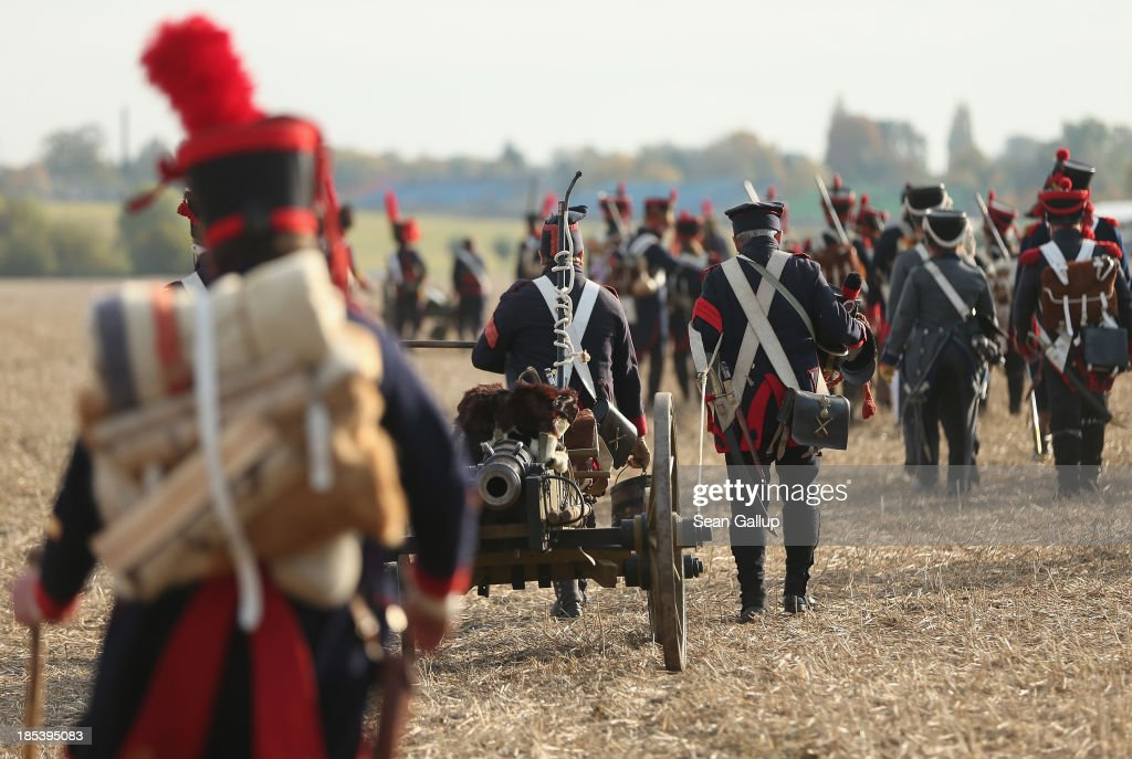 Historical society enthusiasts in the role of French artillery soldiers fighting under Napoleon arrive to re-enact The Battle of Nations on its 200th anniversary on October 20, 2013 near Leipzig, Germany. Over 6,200 actors from 26 countries are participating in the massive re-enactment of the battle that originally pitted 600,000 Austrian, Prussian, Russian and Swedish forces against Napoleon's army near Leipzig in 1813. napoleon's defeat forced him to retreat toward France and sealed the end of his Central European military expansion.