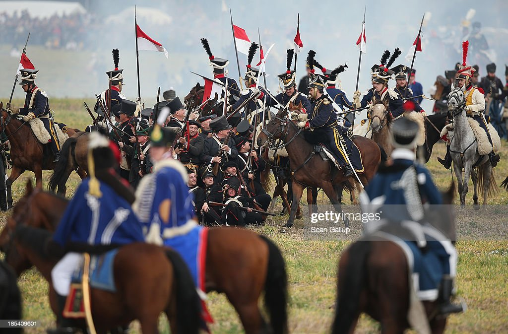 Historical society enthusiasts in the role of Polish lancers loyal to Napoleon retreat during the re-enactment of The Battle of Nations on its 200th anniversary on October 20, 2013 near Leipzig, Germany. Over 6,200 actors from 26 countries are participating in the massive re-enactment of the battle that originally pitted 600,000 Austrian, Prussian, Russian and Swedish forces against Napoleon's army near Leipzig in 1813. Napoleon's defeat forced him to retreat toward France and sealed the end of his Central European military expansion.