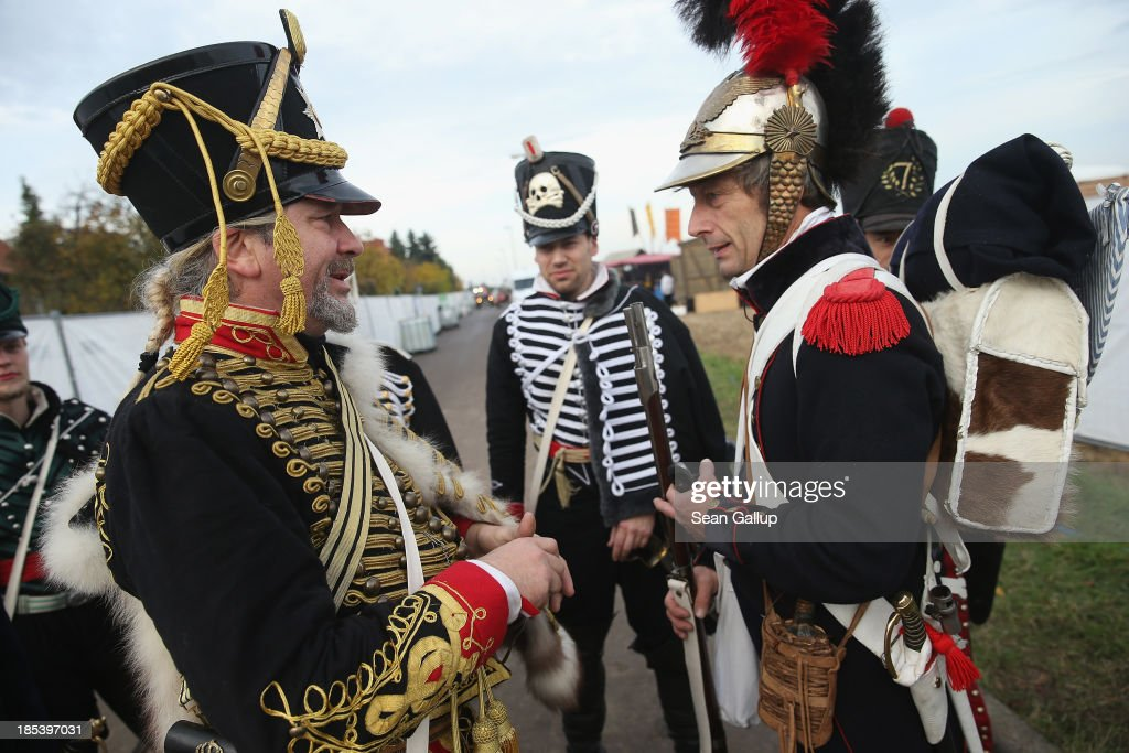 Historical society enthusiasts in the role of protective guards of the Prussian General Staff (L) fighting against Napoleon greet their French enemies, including one actor in the role of General Charles Louis de Lasalle (R), as they arrive to re-enact The Battle of Nations on its 200th anniversary on October 20, 2013 near Leipzig, Germany. Over 6,200 actors from 26 countries are participating in the massive re-enactment of the battle that originally pitted 600,000 Austrian, Prussian, Russian and Swedish forces against Napoleon's army near Leipzig in 1813. napoleon's defeat forced him to retreat toward France and sealed the end of his Central European military expansion.