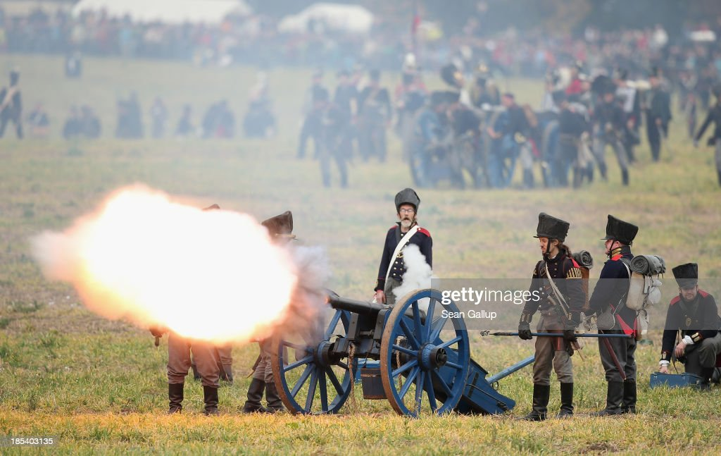 Historical society enthusiasts in the role of Prussian artillery soldiers fire against troops loyal to Napoleon during the re-enactment of The Battle of Nations on its 200th anniversary on October 20, 2013 near Leipzig, Germany. Over 6,200 actors from 26 countries are participating in the massive re-enactment of the battle that originally pitted 600,000 Austrian, Prussian, Russian and Swedish forces against Napoleon's army near Leipzig in 1813. Napoleon's defeat forced him to retreat toward France and sealed the end of his Central European military expansion.