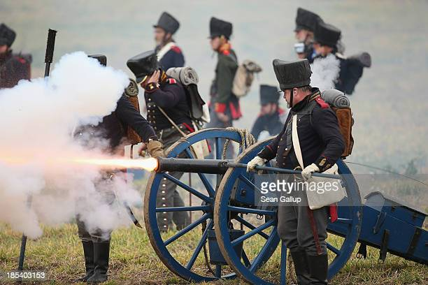 Historical society enthusiasts in the role of Prussian artillery soldiers fire against troops loyal to Napoleon during the reenactment of The Battle...