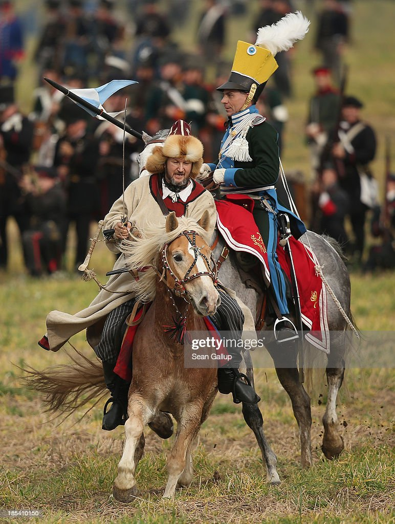 Historical society enthusiasts in the role of troops fighting Napoleon, including one playing a Bishkirian horseman, advance on the enemy during the re-enactment of The Battle of Nations on its 200th anniversary on October 20, 2013 near Leipzig, Germany. Over 6,200 actors from 26 countries are participating in the massive re-enactment of the battle that originally pitted 600,000 Austrian, Prussian, Russian and Swedish forces against Napoleon's army near Leipzig in 1813. Napoleon's defeat forced him to retreat toward France and sealed the end of his Central European military expansion.