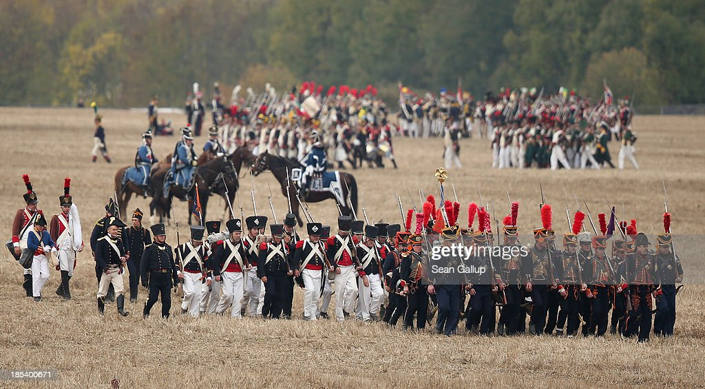 Historical society enthusiasts in the role of troops fighting under Napoleon move into position while re-enacting The Battle of Nations on its 200th anniversary on October 20, 2013 near Leipzig, Germany. Over 6,200 actors from 26 countries are participating in the massive re-enactment of the battle that originally pitted 600,000 Austrian, Prussian, Russian and Swedish forces against Napoleon's army near Leipzig in 1813. Napoleon's defeat forced him to retreat toward France and sealed the end of his Central European military expansion.