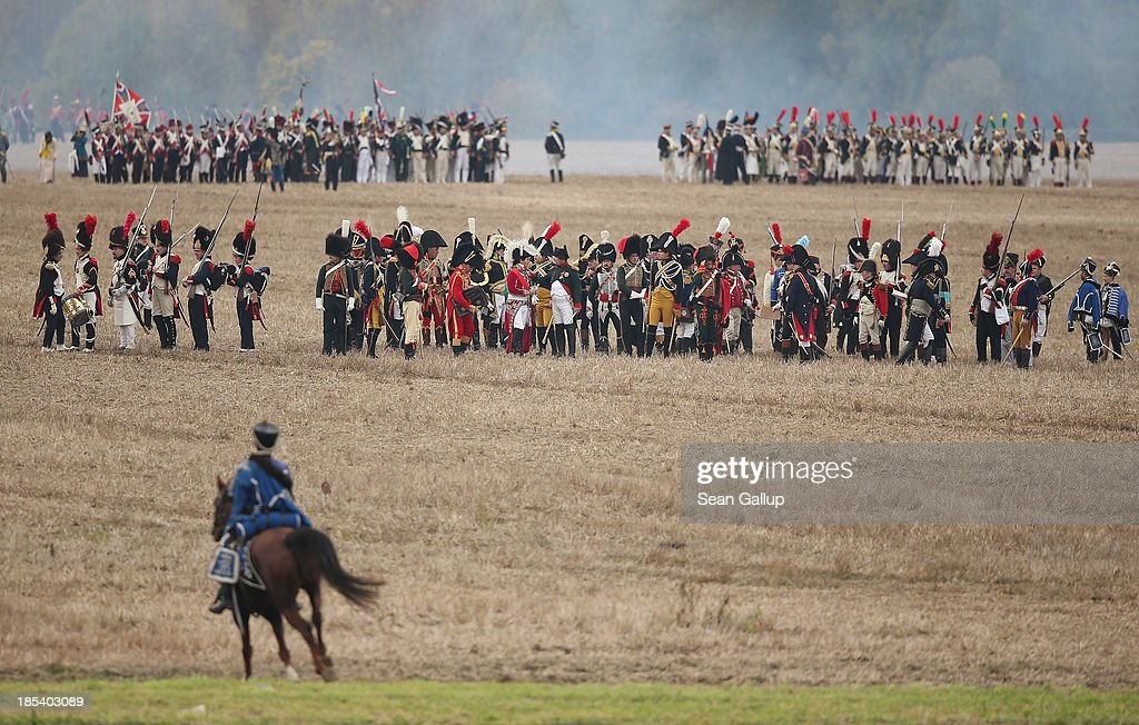 Historical society enthusiasts in the role of troops fighting under Napoleon begin their attack while re-enacting The Battle of Nations on its 200th anniversary on October 20, 2013 near Leipzig, Germany. Over 6,200 actors from 26 countries are participating in the massive re-enactment of the battle that originally pitted 600,000 Austrian, Prussian, Russian and Swedish forces against Napoleon's army near Leipzig in 1813. Napoleon's defeat forced him to retreat toward France and sealed the end of his Central European military expansion.