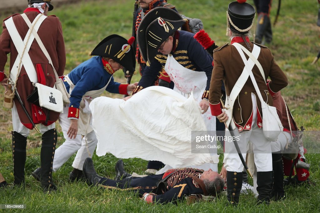 Historical society enthusiasts in the role of troops loyal to Napoleon tend to a ficticiously fallen comrade during the re-enactment of The Battle of Nations on its 200th anniversary on October 20, 2013 near Leipzig, Germany. Over 6,200 actors from 26 countries are participating in the massive re-enactment of the battle that originally pitted 600,000 Austrian, Prussian, Russian and Swedish forces against Napoleon's army near Leipzig in 1813. Napoleon's defeat forced him to retreat toward France and sealed the end of his Central European military expansion.
