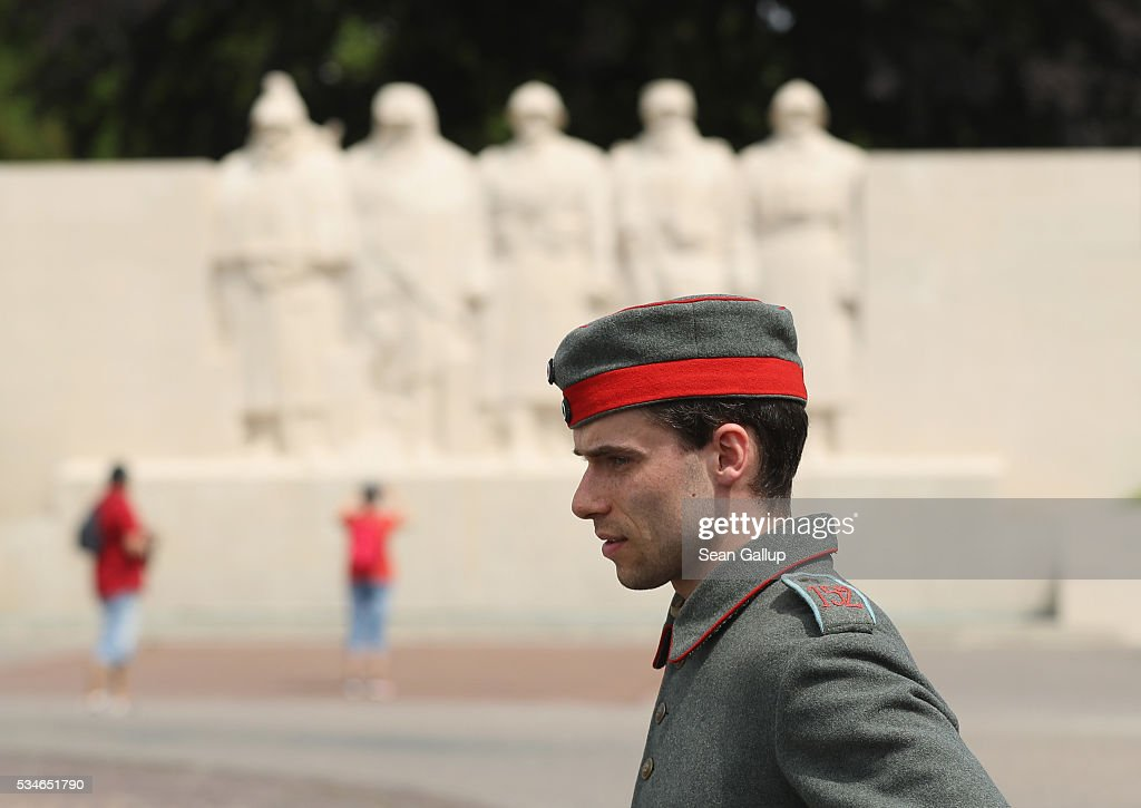 A history buff dressed as a World War I German soldier stands near a monument to French soldiers killed in the World War I Battle of Verdun on May 27, 2016 in Verdun, France. The governments of France and Germany will commemorate the 100th anniversary of the battle with ceremonies this coming Sunday. Approximately 300,000 soldiers lost their lives in the 10-month campaign that was among the most grueling battles of the war.