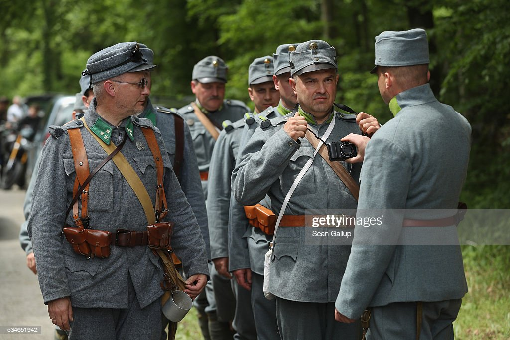 History buffs from Poland wearing World War I military uniforms of the Austro-Hungarian army, including one being reprimanded for wearing a digitial camera inappropriate to the historical detail of his uniform, arrive at the ossuary of Douaumont at the Verdun World War I battefield site on May 27, 2016 in Verdun, France. The governments of France and Germany will commemorate the 100th anniversary of the battle with ceremonies this coming Sunday. Approximately 300,000 soldiers lost their lives in the 10-month campaign that was among the most grueling battles of the war.